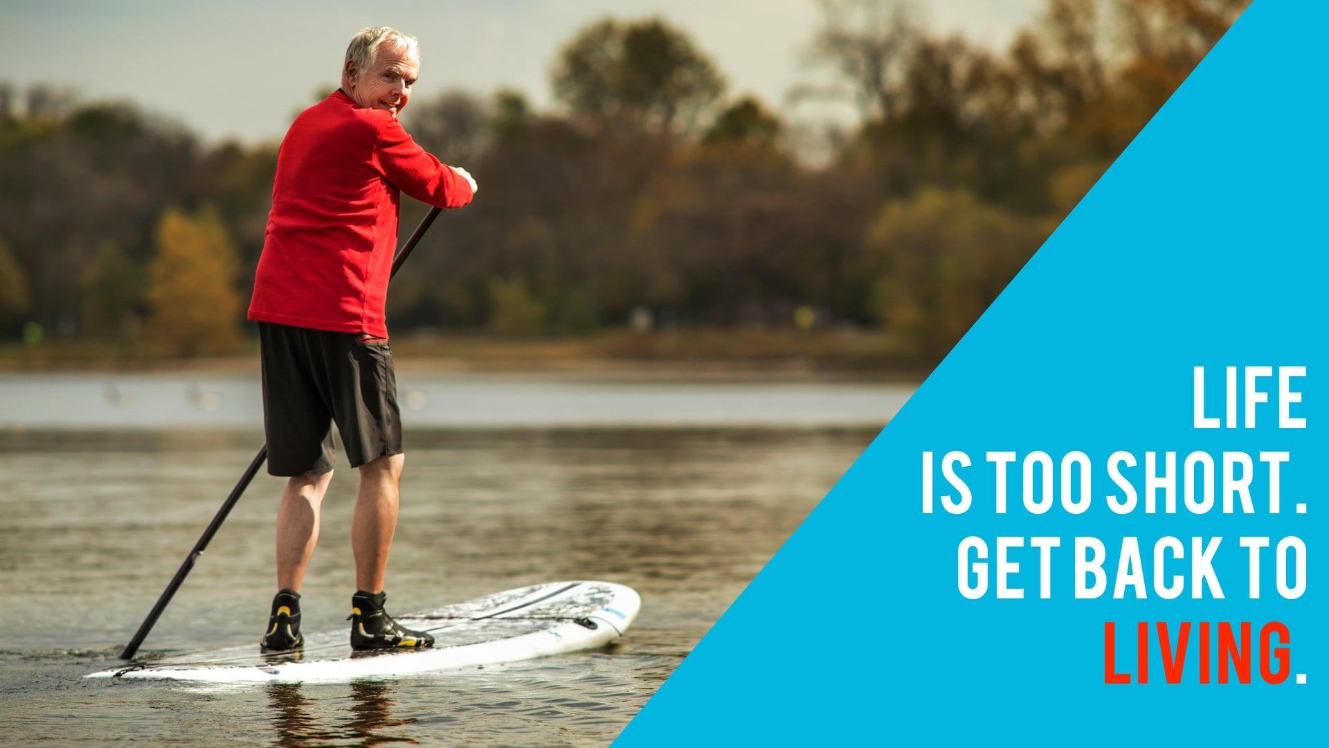 mature male balanced on a paddleboard