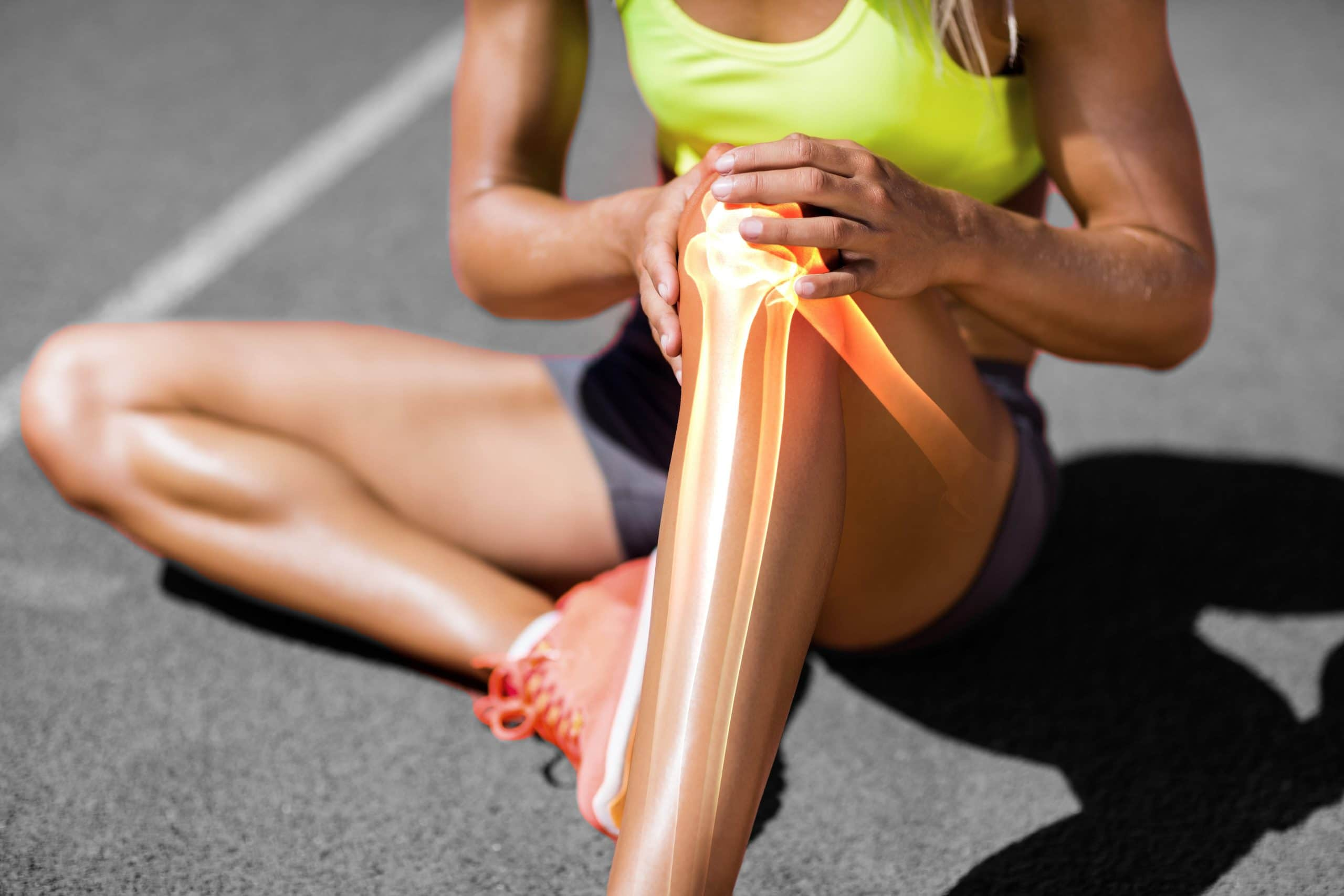 female runner experiencing knee pain