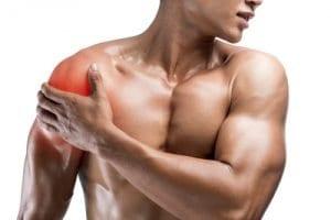 Athletic Male Holding Sore Shoulder
